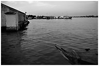 Floating houses. They double as fish reservoirs. Chau Doc, Vietnam ( black and white)
