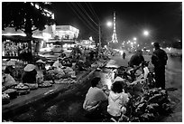 Night market and the local Eiffel tower. Da Lat, Vietnam ( black and white)