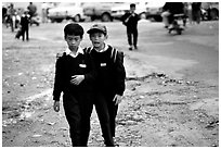 School children wear French-style chic sweaters. Da Lat, Vietnam ( black and white)