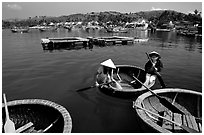 Circular basket boats, typical of the central coast, Nha Trang. Vietnam ( black and white)