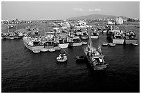 Colorfull fishing boats. Note the circular basket boats used to get to shore.  Nha Trang. Vietnam (black and white)