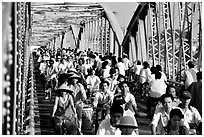 Rush hour on the Trang Tien bridge. The numbers of cars is insignificant compared to Ho Chi Minh city. Hue, Vietnam (black and white)
