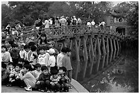 School children at The Huc bridge, Hoan Kiem lake. Hanoi, Vietnam (black and white)