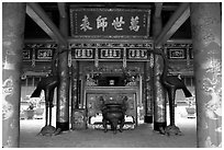 Red columns and altar with phoenix, Temple of the Literature. Hanoi, Vietnam (black and white)