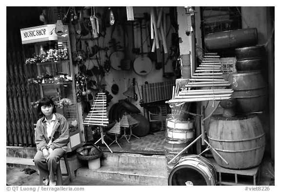 Black and white picture photo traditional musical instruments for sale old quarter hanoi vietnam