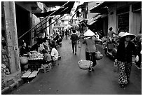 Street scene in the old city. Hanoi, Vietnam (black and white)