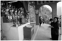 Praying at an outdoor temple. Perfume Pagoda, Vietnam (black and white)