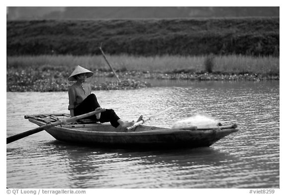 The local technique of paddling with feet, Ken Ga canal. Ninh Binh,  Vietnam (black and white)