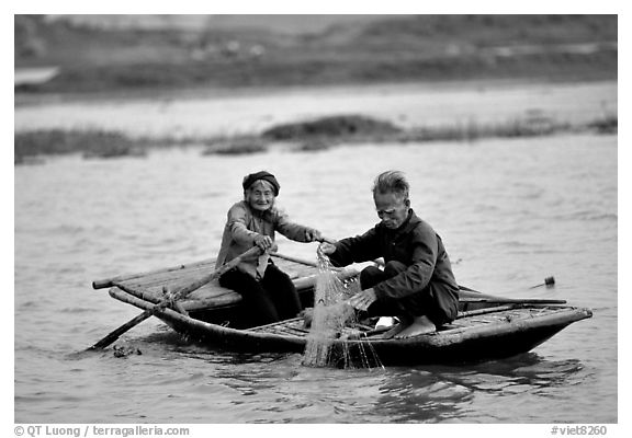 Elderly couple fishing, Ken Ga canal. near Ninh Binh,  Vietnam