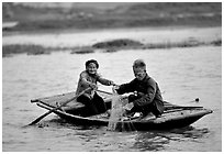 Elderly couple fishing, Ken Ga canal. Ninh Binh,  Vietnam ( black and white)