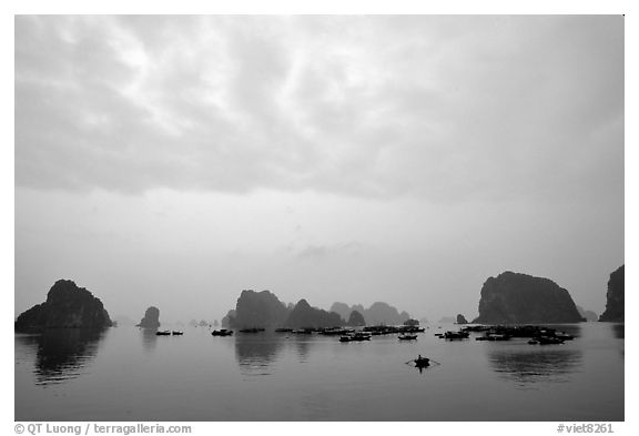 Distant view of the bay with its three thousands limestone islets. Halong Bay, Vietnam (black and white)