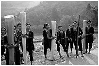 Ethnic minority women carrying banana trunks. Vietnam (black and white)