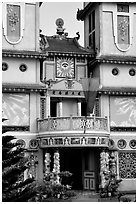 Facade detail of a Cao Dai temple. Mekong Delta, Vietnam (black and white)
