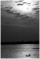 Small boat at sunrise. Chau Doc, Vietnam (black and white)