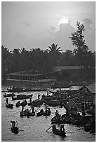River activity at sunrise. Can Tho, Vietnam ( black and white)