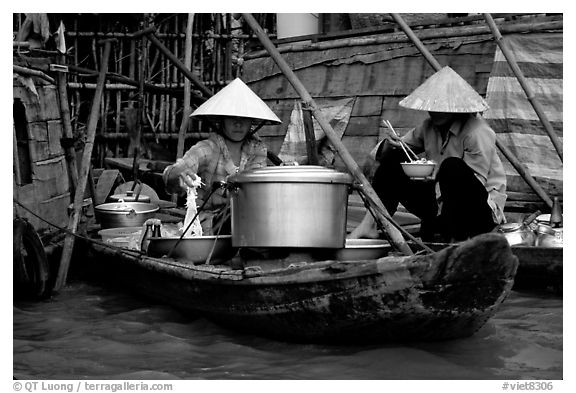 Boat-based food vendors. Can Tho, Vietnam (black and white)