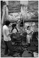 Hairdressing in the street. Ho Chi Minh City, Vietnam (black and white)