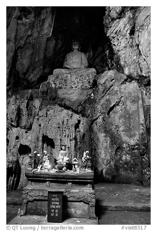 Altar and Buddha statue in a troglodyte sanctuary of the Marble Mountains. Da Nang, Vietnam