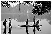 Children playing,  Hoan Kiem Lake. Hanoi, Vietnam (black and white)