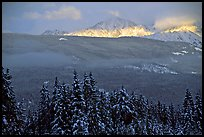 Snowy peaks hit by a ray of sun after a winter storm. Banff National Park, Canadian Rockies, Alberta, Canada