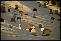 Tombs with crosses in snow. Calgary, Alberta, Canada (color)
