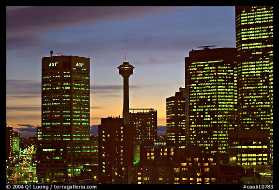 Tower and high-rise buildings, at dusk. Calgary, Alberta, Canada