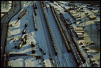 Rail tracks and cargo cars in winter. Calgary, Alberta, Canada