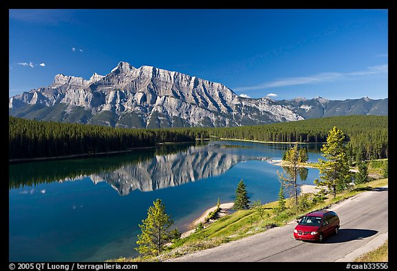 Car on the road besides Two Jack Lake. Banff National Park, Canadian Rockies, Alberta, Canada