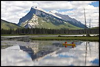 Canoe and Mt Rundle reflection in first Vermillion Lake, afternon. Banff National Park, Canadian Rockies, Alberta, Canada
