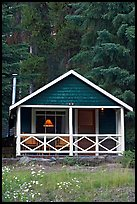 Cabin in the woods with interior lights. Banff National Park, Canadian Rockies, Alberta, Canada