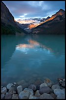 Boulders, Lake Louise, and Victoria Peak, sunrise. Banff National Park, Canadian Rockies, Alberta, Canada (color)