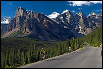 Cyclists on the road to the Valley of Ten Peaks. Banff National Park, Canadian Rockies, Alberta, Canada (color)