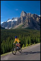 Cyclist on the road to the Valley of Ten Peaks. Banff National Park, Canadian Rockies, Alberta, Canada