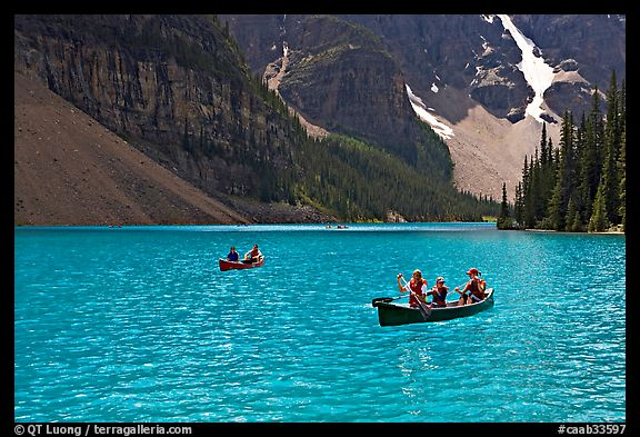 Canoes on the robbin egg blue Moraine Lake, afternoon. Banff National Park, Canadian Rockies, Alberta, Canada (color)