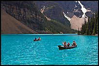 Canoes on the robbin egg blue Moraine Lake, afternoon. Banff National Park, Canadian Rockies, Alberta, Canada