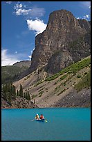 Canoe on Moraine Lake, afternoon. Banff National Park, Canadian Rockies, Alberta, Canada (color)