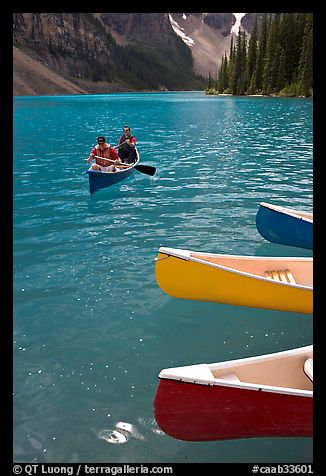Colorful canoes and conoeists on Moraine Lake. Banff National Park, Canadian Rockies, Alberta, Canada (color)