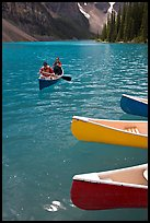 Colorful canoes and conoeists on Moraine Lake. Banff National Park, Canadian Rockies, Alberta, Canada ( color)