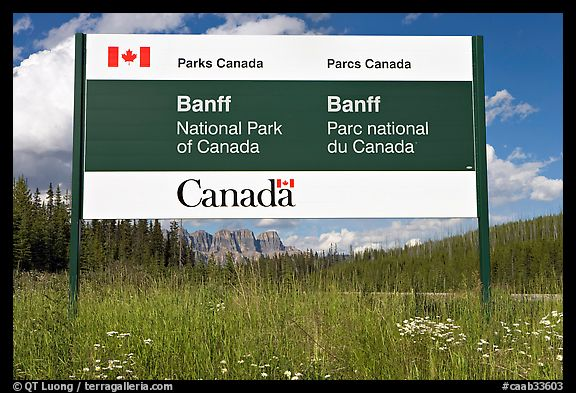 Bilingual sign at the entrance of the Park. Banff National Park, Canadian Rockies, Alberta, Canada (color)