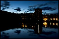 Chateau Lake Louise Hotel reflected in Lake at night. Banff National Park, Canadian Rockies, Alberta, Canada