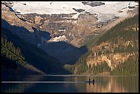 Rowers on Lake Louise, below Victoria Glacier, early morning. Banff National Park, Canadian Rockies, Alberta, Canada