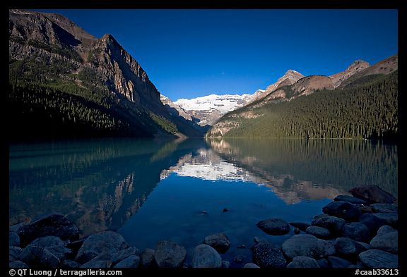 Mountains reflected in Lake Louise, early morning. Banff National Park, Canadian Rockies, Alberta, Canada