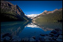 Mountains reflected in Lake Louise, early morning. Banff National Park, Canadian Rockies, Alberta, Canada (color)