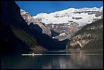 Rower, Lake Louise, and Victoria Peak, early morning. Banff National Park, Canadian Rockies, Alberta, Canada