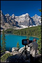 Photographer operating a 8x10 view camera at Moraine Lake. Banff National Park, Canadian Rockies, Alberta, Canada
