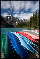 Colorful canoes stacked on the boat dock, Lake Moraine, morning. Banff National Park, Canadian Rockies, Alberta, Canada