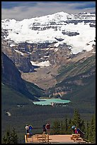 Visitors at observation platform, looking at  Lake Louise and  Victoria Peak. Banff National Park, Canadian Rockies, Alberta, Canada