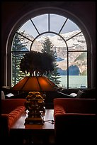 Lake Louise seen through a window of Chateau Lake Louise hotel. Banff National Park, Canadian Rockies, Alberta, Canada