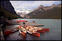 Red canoes at boat dock, Lake Louise, morning. Banff National Park, Canadian Rockies, Alberta, Canada