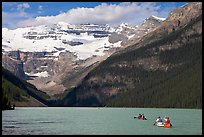 Canoes, Victoria Peak, and blue-green glacially colored Lake Louise, morning. Banff National Park, Canadian Rockies, Alberta, Canada